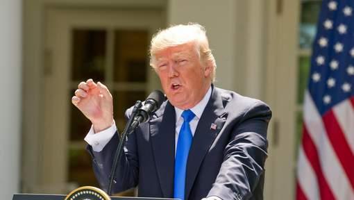 Trump critique la suspension par la justice de son décret migratoire