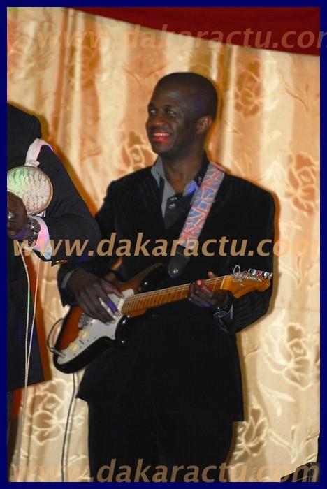 A la guitare, Malick Diop.