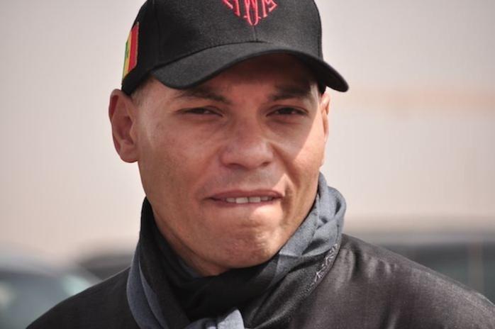 Présenté devant le juge , Karim Wade reste en prison