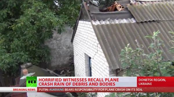 Un cadavre du vol MH17 transperce le toit d'une maison