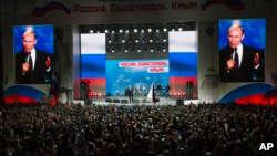 Poutine réélu pour un 4e mandat avec 73,9% des voix