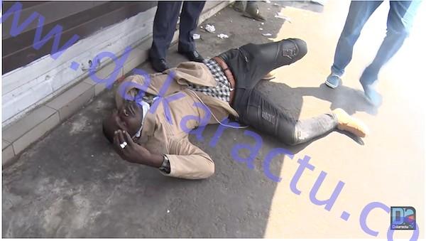 SANDAGA : Un manifestant à terre à cause des lacrymogènes