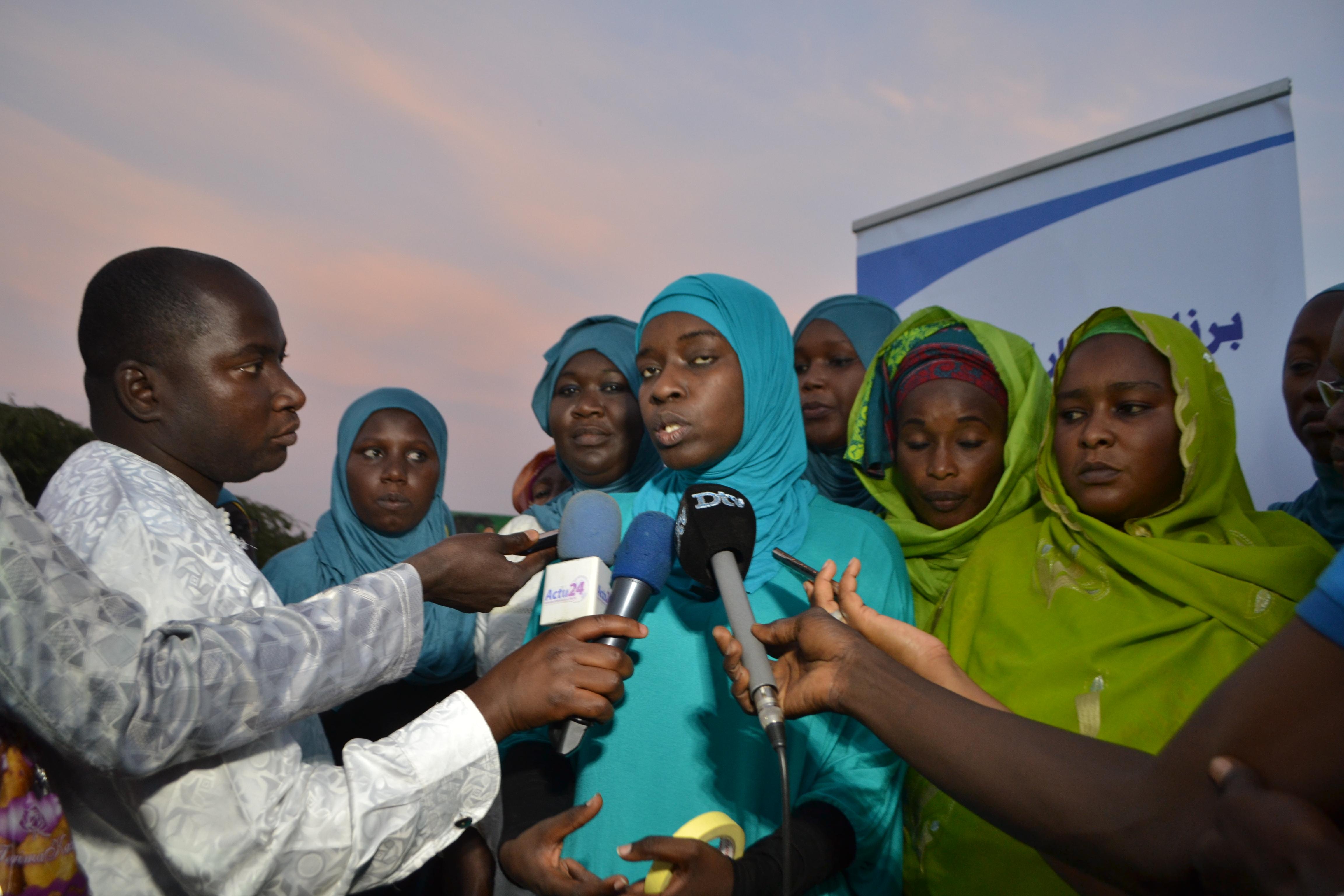 Les images de la distribution de n'dogou par les femmes du Ris ( Rassemblement islamique du Sénégal ) dirigées par la journaliste Hourèye Thiam Preira