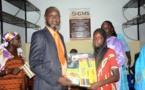 Maïmouna NDOYE SECK Présidente du GMS offre  200 lots de fournitures scolaires…