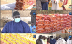 Aide alimentaire à Touba / Serigne Bassirou Mbacké Khadim Awa Bâ empile sacs de riz et aligne bidons d'huile.